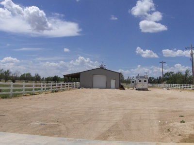 Option to purchase 6 acres plus barn ,pens,arena